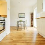 colour image kitchen in newly restored rebuilt house work surfaces